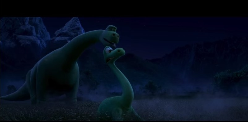 Arlo's father urges him to walk forward in this still from The Good Dinosaur