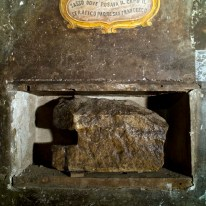 "A stone believed to be used by St. Francis of Assisi as a pillow is on display in a cell of the convent of St. Francesco a Ripa in Rome, Friday, Feb. 28, 2014, that he is believed to have visited on the occasion of his trips to the city. The inscription reads in Italian: ""Stone where the Serafic Father St. Francis would rest his head"". The friars who run the St. Francis a Ripa church in Rome's Trastevere neighborhood are launching a Kickstarter online fundraising campaign Tuesday, March 11, 2014, to try to raise the $125,000 to restore the tiny cell upstairs from the sacristy where St. Francis stayed, The Associated Press has learned. Rather than ask for funding from the Italian government, which owns the church and is responsible for its upkeep, the friars decided on this more democratic crowdfunding initiative thinking it more in keeping with the Franciscan tradition of seeking alms for just what they need, spreading the faith as they beg, and making sure the poor are the priority. (AP Photo/Domenico Stinellis)"