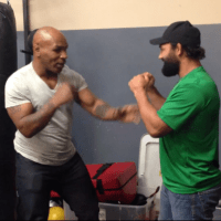 Mike Tyson teaching Johnny Hendricks a thing or two.