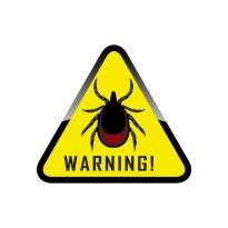 gele driehoek met waarschuwing voor teken