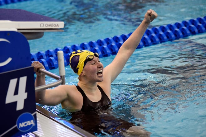Michigan Wolverines women's swimming and diving junior Olivia Carter, a Georgia transfer, celebrates the national championship in the 200-yard butterfly event.