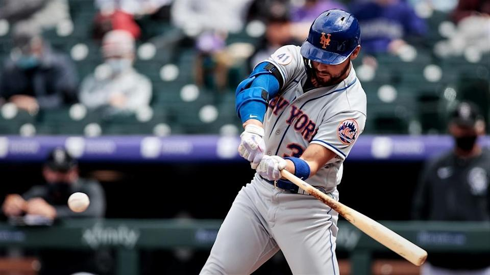 Apr 18, 2021; Denver, Colorado, USA; New York Mets right fielder Michael Conforto (30) hits a double in the second inning against the Colorado Rockies at Coors Field. Mandatory Credit: Isaiah J. Downing-USA TODAY Sports