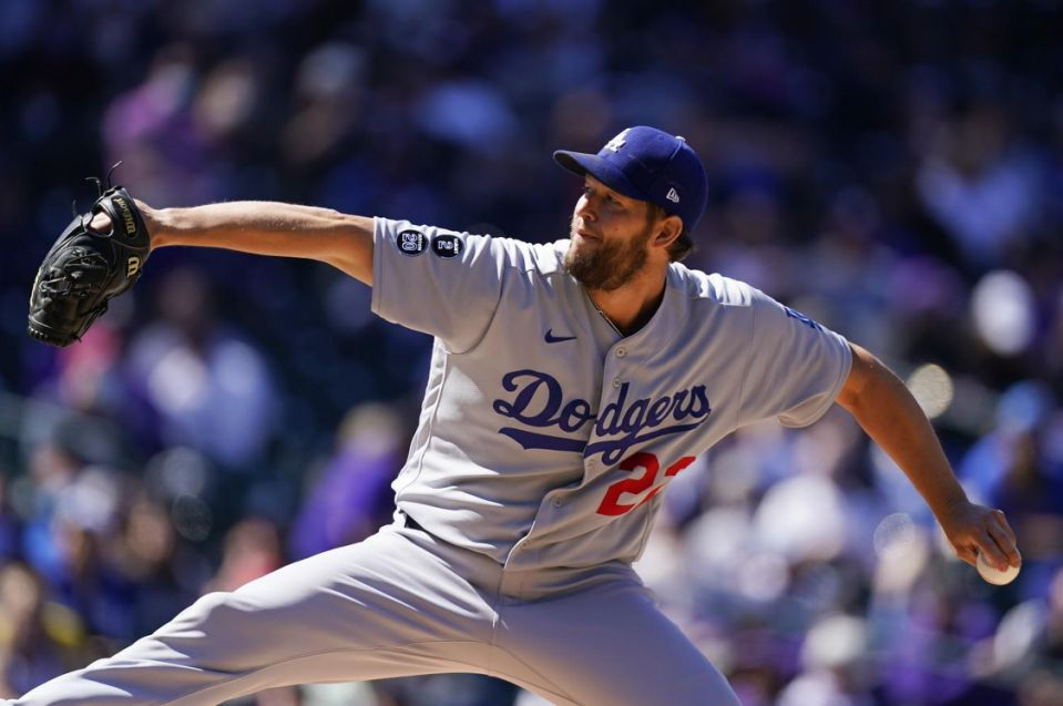 Dodgers pitcher Clayton Kershaw works against the Colorado Rockies.