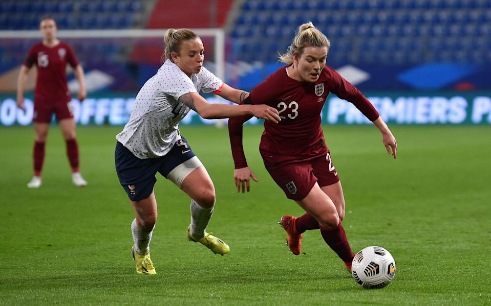Lauren Hemp of England turns away from Marion Torrent of France during the International Friendly Match between France and England at Stade Michel D'Ornano on April 09, 2021 in Caen, France. - GETTY