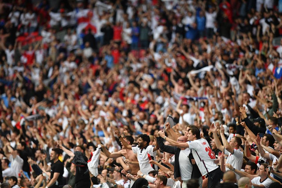 England supporters celebrate their win in the UEFA EURO 2020 round of 16 football match between England and Germany at Wembley Stadium in London on June 29, 2021. (Photo by JUSTIN TALLIS / POOL / AFP) (Photo by JUSTIN TALLIS/POOL/AFP via Getty Images)