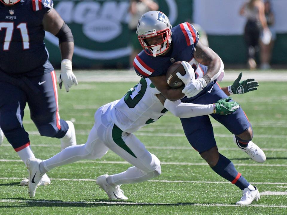 James White fights through a tackle against the New York Jets.