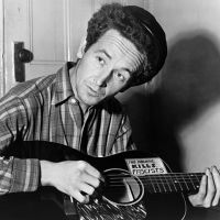 """""""This Land Is Your Land,"""" by Woody Guthrie, a popular American folk song among patriots, was originally created as a criticism of Capitalism and the U.S. government by a Communist labor organizer."""