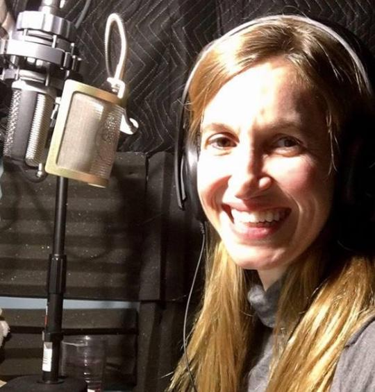 Marnye Young Narrator Photo with Microphone