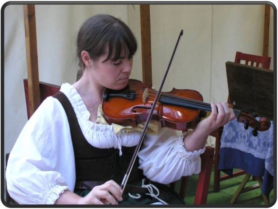 Tiffani Collins Author photo with violin