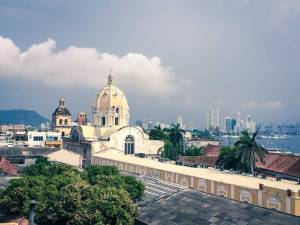 Church dome overlooking mountains and sea, Cartagena, Colombia, Fantasy Aisle Travel