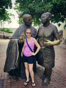 Kelly with two statues speaking, Cartagena, Colombia, Fantasy Aisle Travel