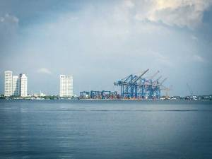 Ship cranes in Cartagena Bay, Cartagena, Colombia, Fantasy Aisle Travel