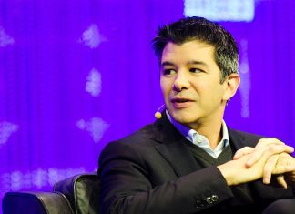 Uber CEO travis kalanick sitting on a chair with his hands crossed at chest level