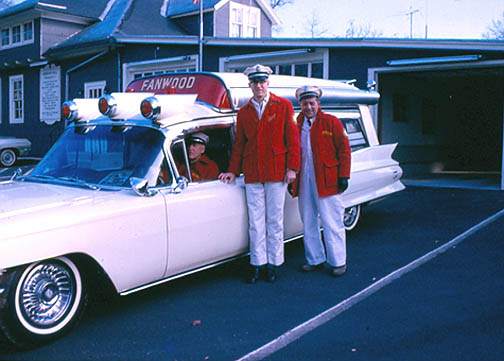 Capt. Jack Mesereau, circa 1965, with Russ Scott at the wheel and unidentified member at far right.