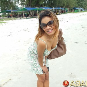 Beach cleavage sexy Asian girl in sunglasses