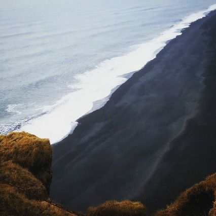 View of a black volcanic beach from #dyrholaey #cliff #iceland #travel #travelgram