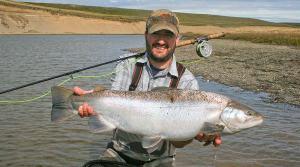 Calvin Fuller with sea run brown trout from the rio grande in tierra del fuego