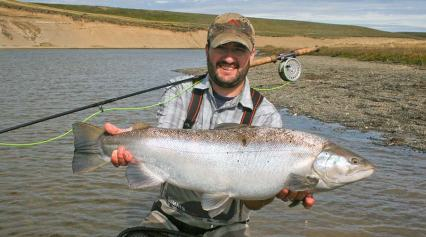 Calvin Fuller with sea run brown trout from the rio grande in tierra del fuego