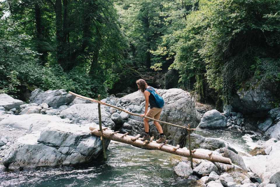Sabina crossing a river in Georgia
