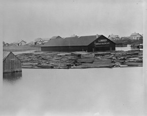 Chesley & Lovejoy Lumberyard at high water from Red River flood, Fargo, N.D., Downtown, 1881