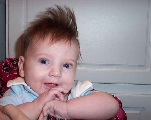 A very young Brian with very crazy hair.