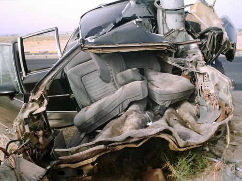 1980s Caprice Classic smashed sideways into a light pole on Expressway 30 near Ali Sabah Al Salem, May 12 2005