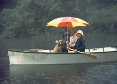 Scott Alan Miller, Karen Miller, Jonathan Stagno and Buffer in Rowboat in Rain