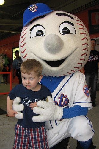 Mr. Met terrorizing a small child.  Photo by Swerz