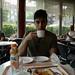 Ishir sips a cappuccino in Duc de Lorraine