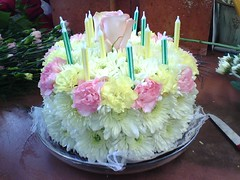 A birthday cake made of flowers