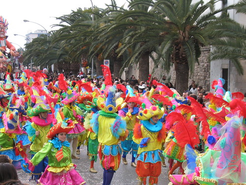 A colorful group dances at Carnevale