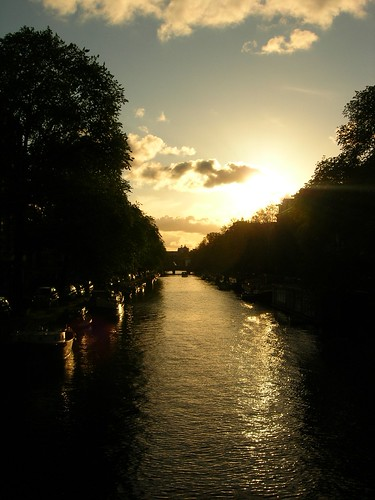 Sun setting over a canal