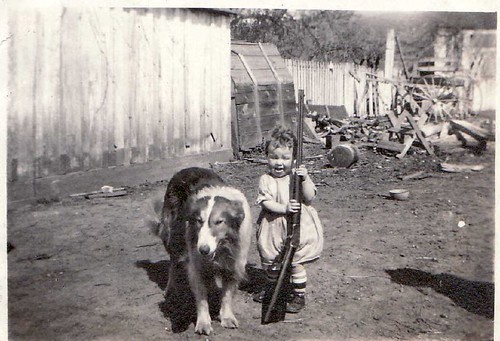 Mary Jean with gun an dawg