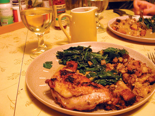 Broiled chicken with collard greens and stuffing