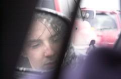 Alex, in a car mirror
