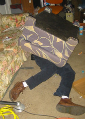 20040327 - hanging out - 100-0002 - John the Canadien under the ottoman