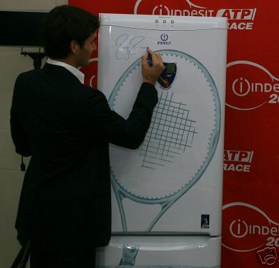 Roger Federer signs the Indesit Fridge