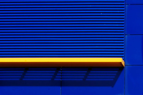 yellow line on  blue wall