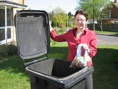 Kelsie Learney takes kitchen waste out of her bin