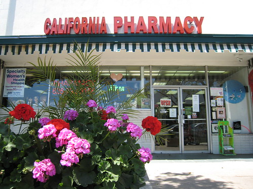 California Pharmacy, as seen from behind the geranium planter