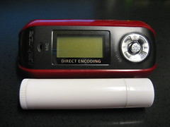 Size comparison of an iRiver iFP-899 and lip balm