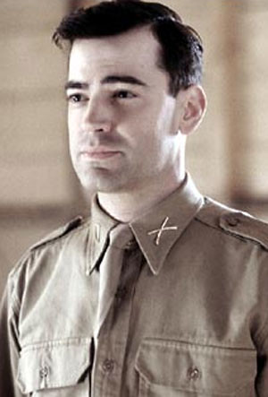 in Band of Brothers, he didnt have the fat neck that he sported in Office Space.