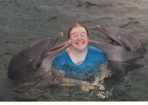 Sarah with dolphins