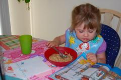 Grace reads her magazine as she eats breakfast!