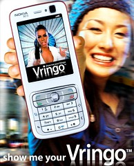 Asian woman with Vringo on Nokia Handset