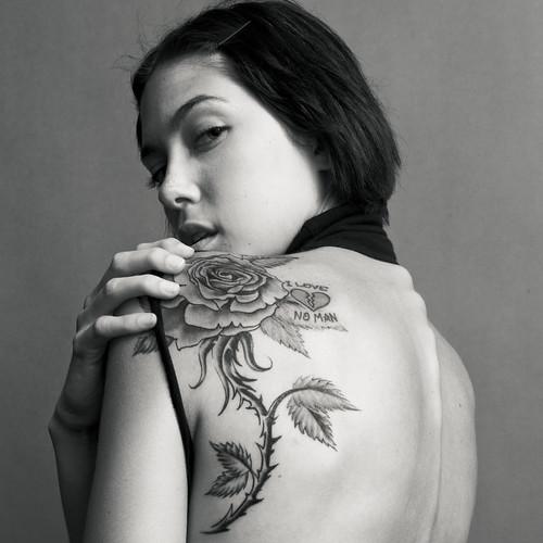Rose tattoo designs show life, birth, procreation,