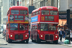 Two double-decker Routemaster buses, London by Salim Virji