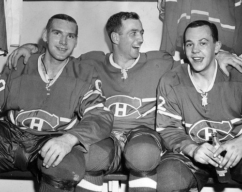 Dick Duff (centre) celebrates winning the Stanley Cup in 1966 with Dave Balon, left, and Yvan Cournoyer.