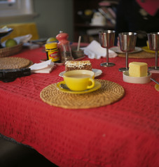 Cup of tea and cake on a red table cloth