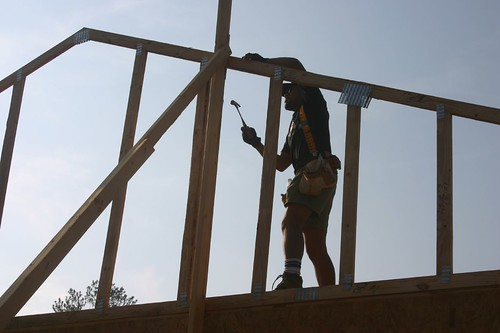 nailing the first truss to the safety pole